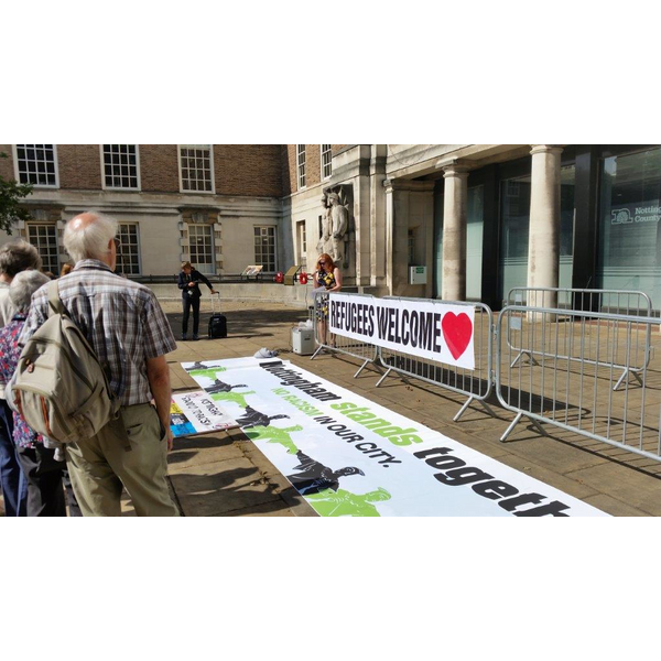 Protest against dropped commitment to helping child migrants